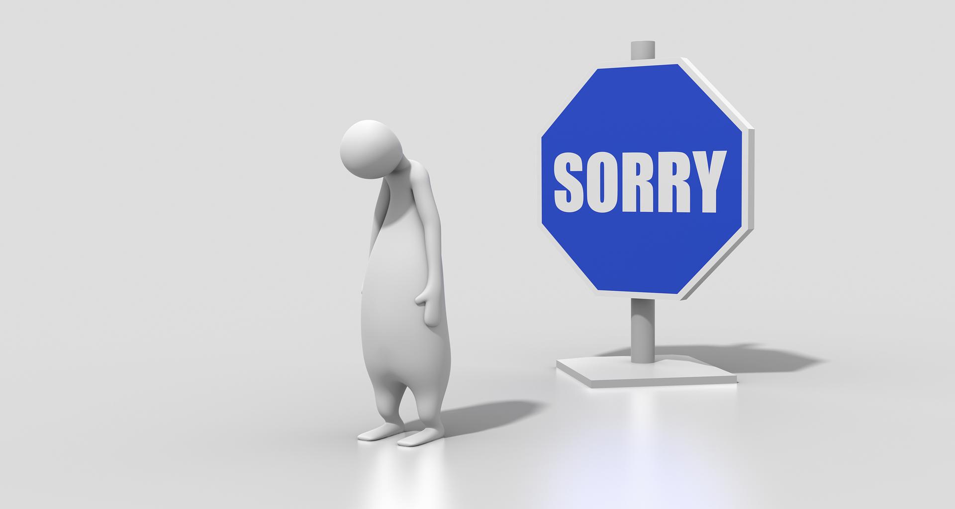 謝罪する姿